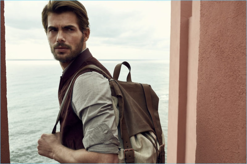 Embracing a casual look from Brunello Cucinelli, Jacey Elthalion sports a canvas and leather backpack $2,695.