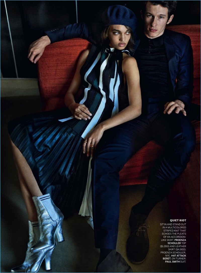 Relaxing, Callum Turner sports a Paul Smith suit for the pages of Vogue.