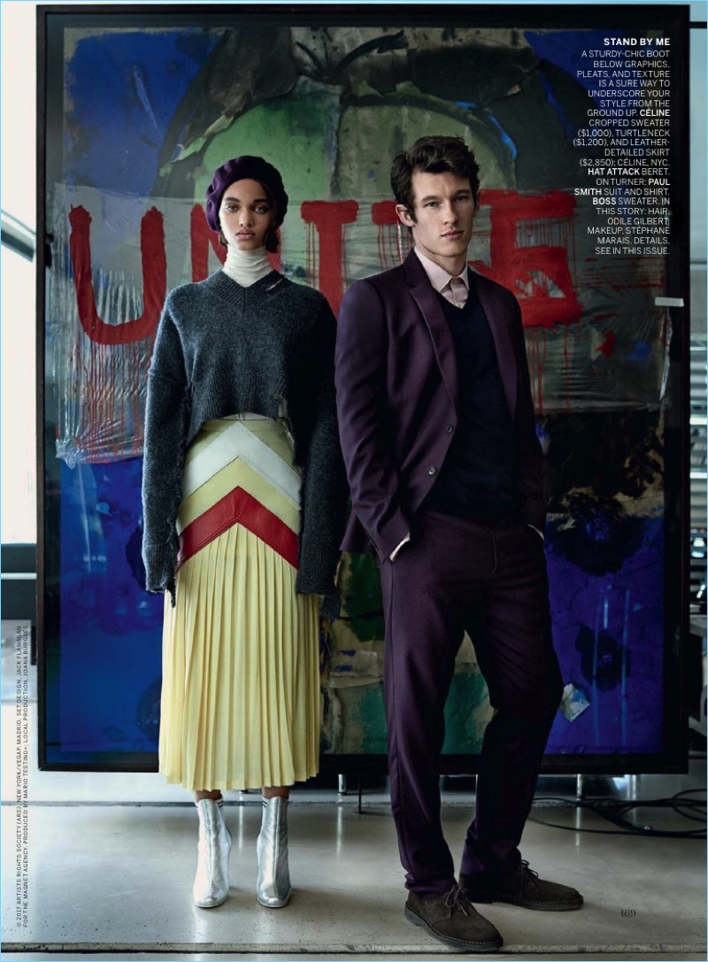 Standing tall with Ellen Rosa, Callum Turner sports a Paul Smith shirt and purple suit with a BOSS Hugo Boss sweater.