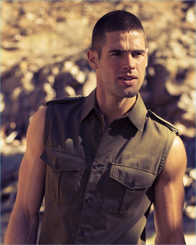 Tapping into the military trend, Chad White wears a sleeveless shirt with epaulets from Louis Vuitton.