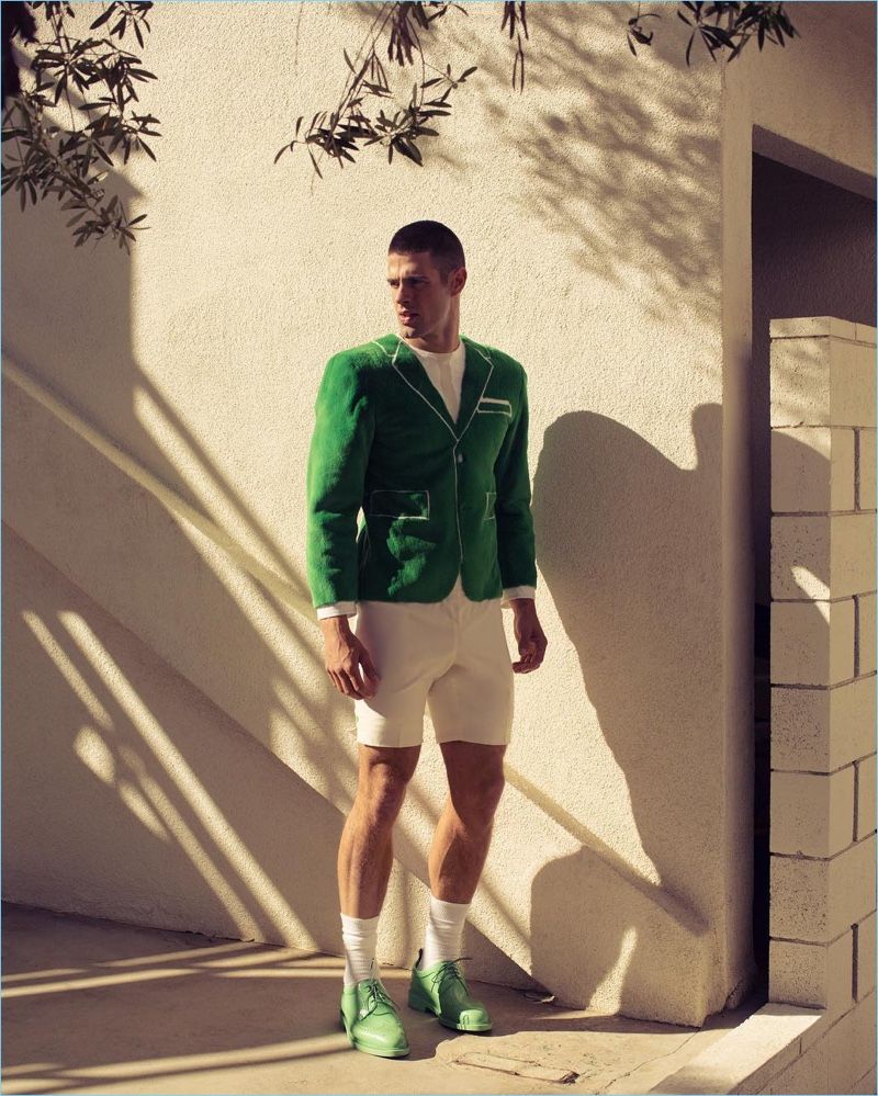 Making a quirky style statement, Chad White wears a faux suiting look from Thom Browne.