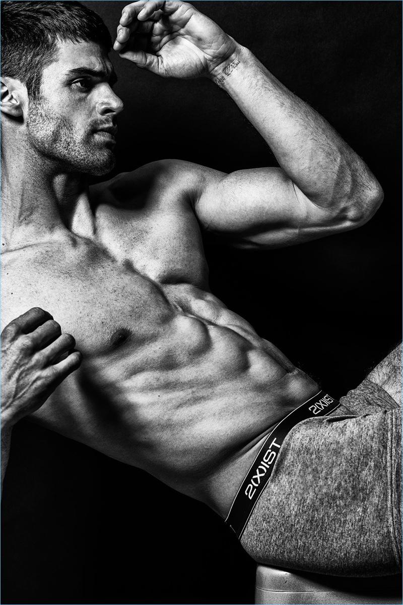 American model Chad White flexes in 2(X)IST underwear.
