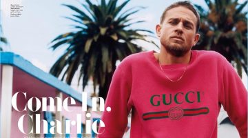 Charlie Hunnam wears a red Gucci sweatshirt with a Marla Aaron necklace.