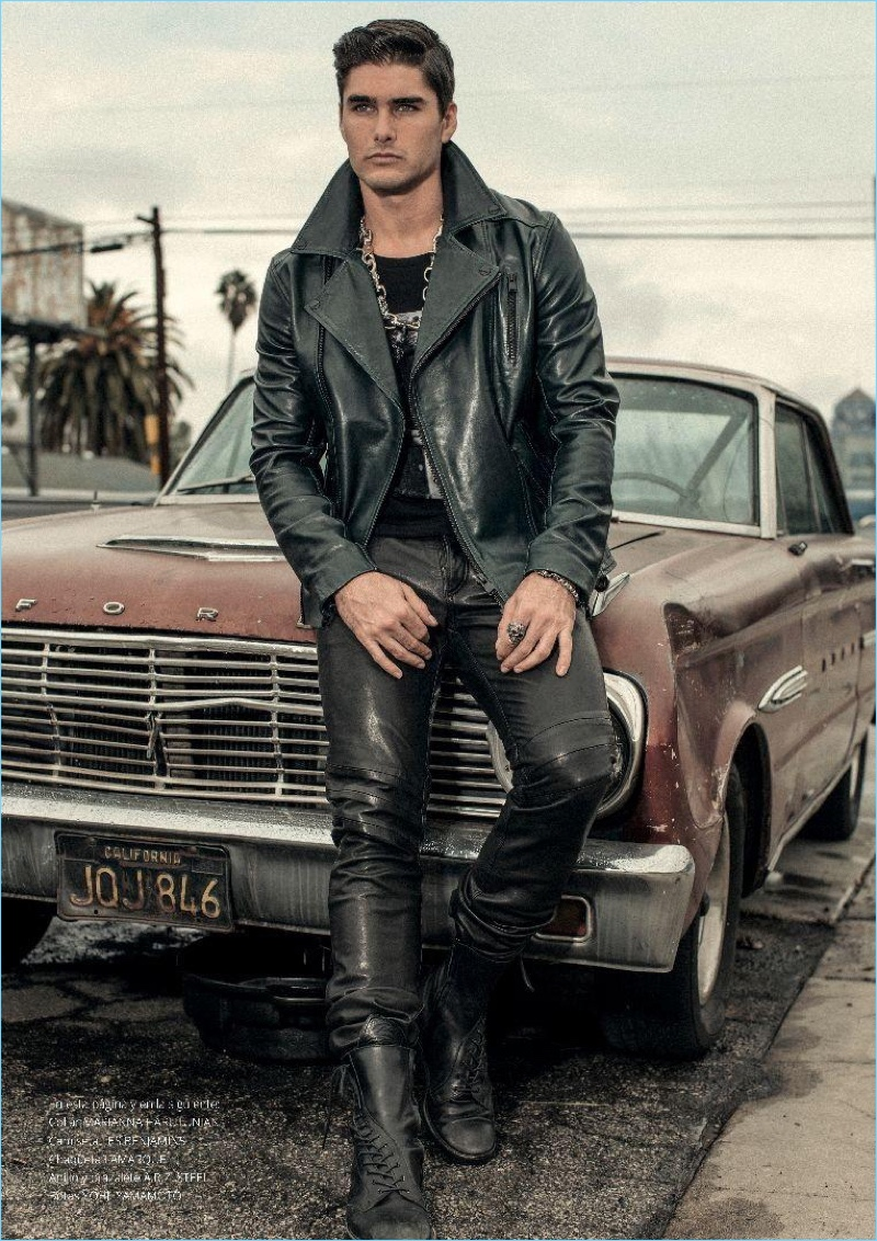Posing against an old Ford car, Charlie Matthews stars in an editorial for Risbel magazine.