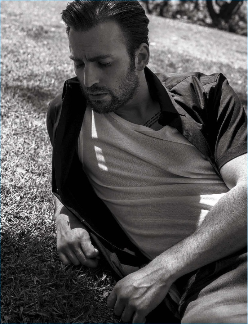 Starring in a photo shoot for L'Uomo Vogue, Chris Evans wears a Theory shirt with J Brand pants.