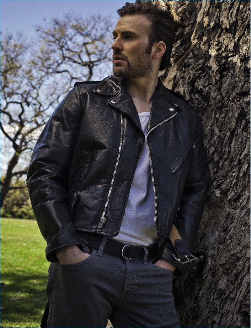 A cool vision, Chris Evans wears a leather biker jacket by What Goes Around Comes Around with J Brand pants.