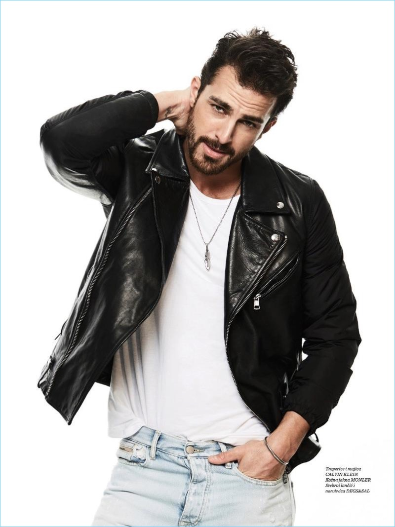 Sporting classic style, Clint Mauro wears a leather biker jacket with a simple tee and light wash jeans.