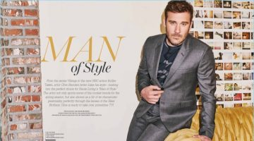 Clive Standen wears a grey Paul Smith suit with a Sandro t-shirt for Haute Living.
