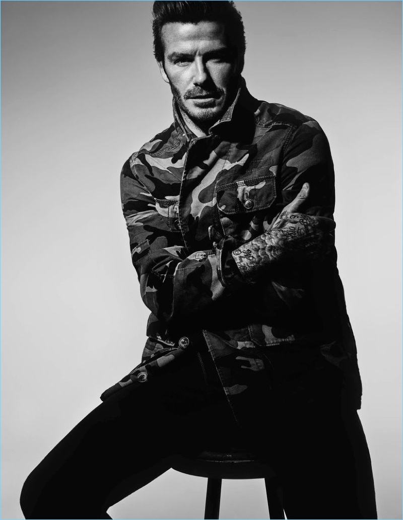 Embracing camouflage, David Beckham wears a Valentino jacket with Saint Laurent jeans.