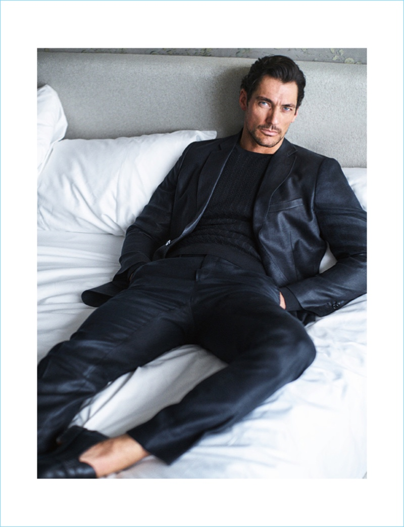 Relaxing in bed, David Gandy wears a tailored look by Massimo Dutti.