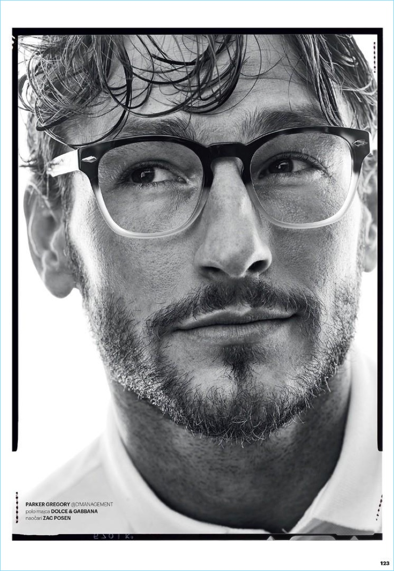 Parker Gregory wears a Dolce & Gabbana polo with Zac Posen glasses.