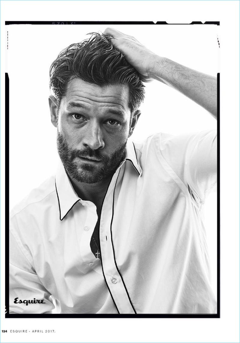 John Halls dons a Canali white shirt with black trim.