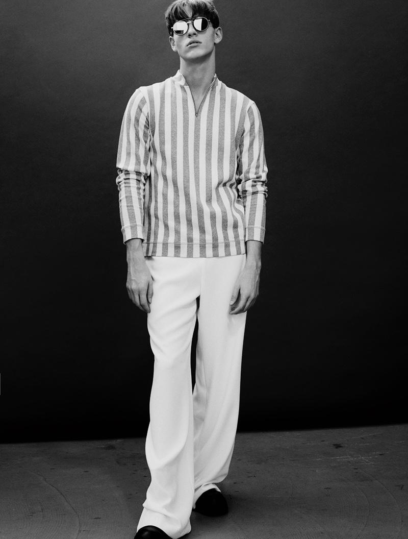 Oskar wears glasses Dior, striped shirt Libertine Libertine, pants Zara, and boots Filippa K.