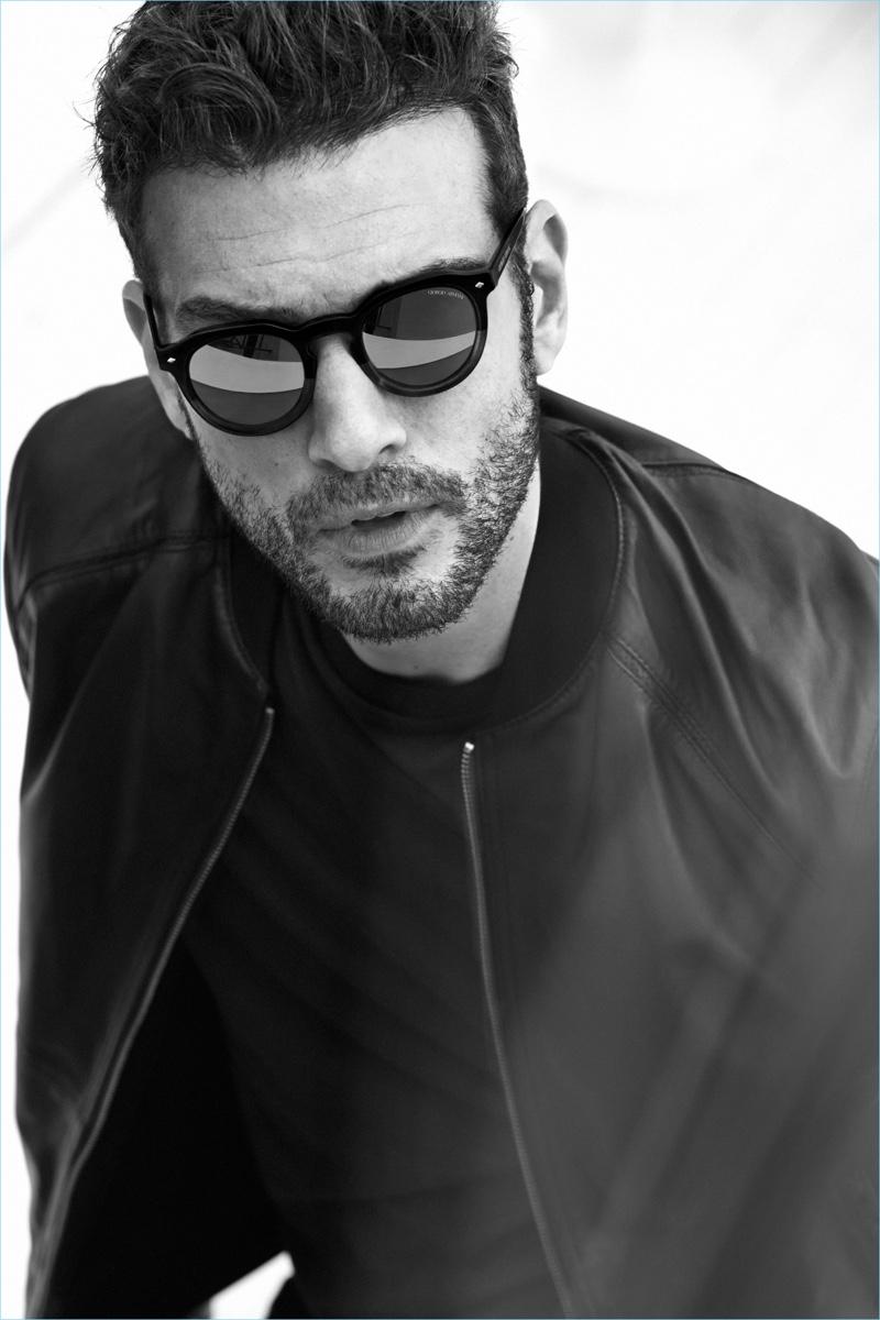 Sporting sunglasses, Tristan wears Giorgio Armani's AR 8093 style.