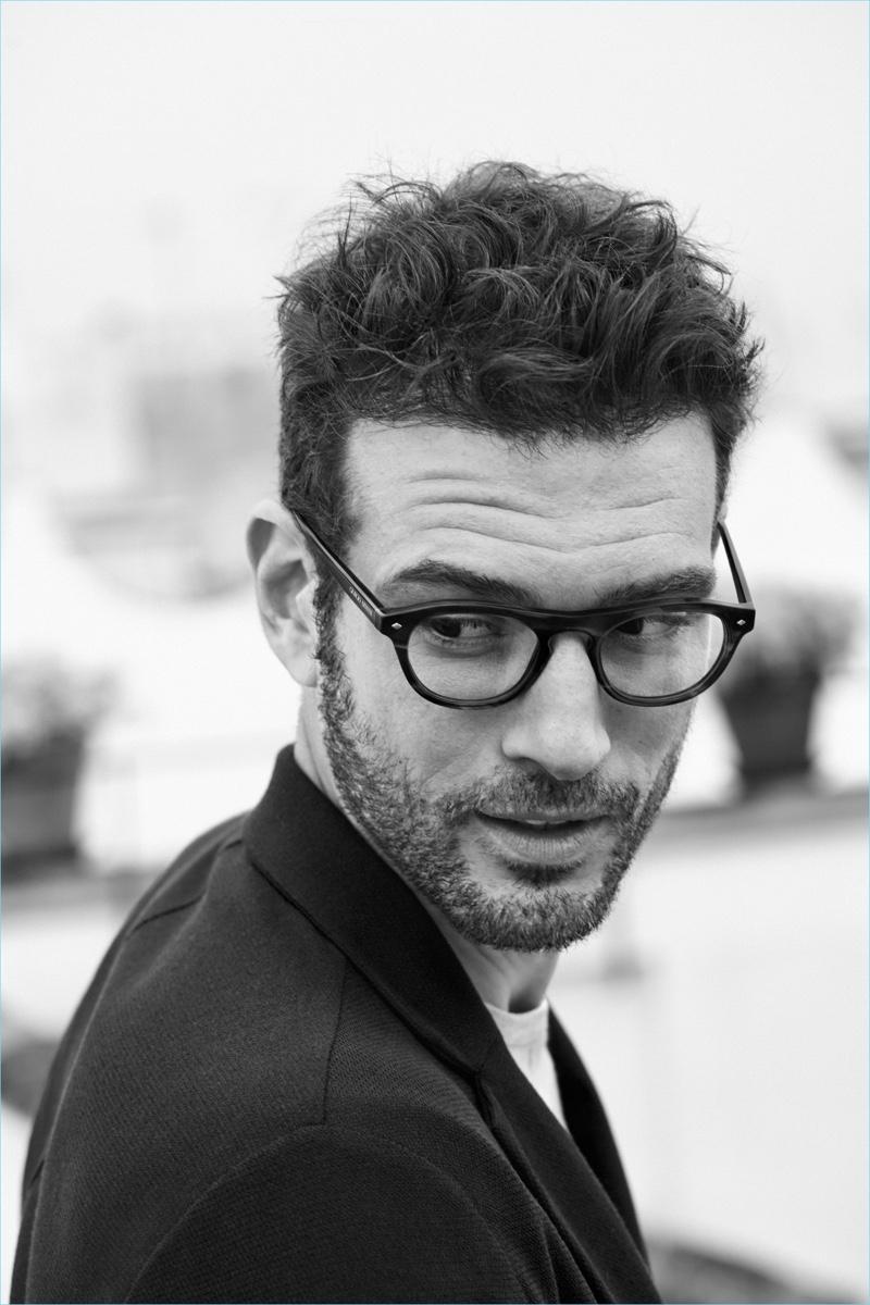 Donning a classic style, Tristan wears Giorgio Armani's AR 7132 tortoiseshell framed glasses.