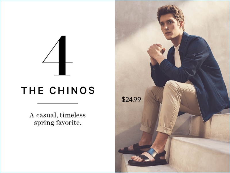 Relaxing, Otto Lotz wears a H&M denim shirt jacket $34.99, cotton t-shirt $14.99, slim-fit cotton chinos $24.99, and leather sandals $49.99.