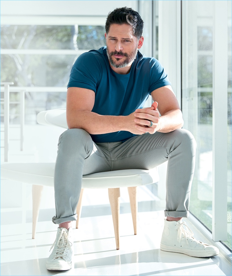 Actor Joe Manganiello wears a COS t-shirt with Bottega Veneta jeans, and Converse high-top sneakers.