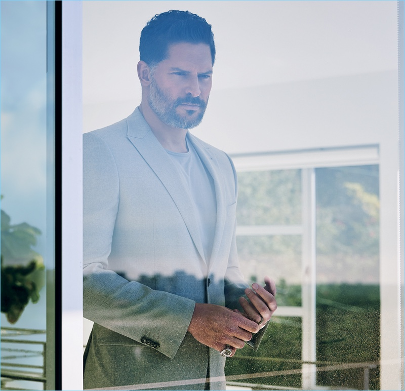 Embracing a sleek look, Joe Manganiello wears a Joseph Abboud suit with a COS t-shirt.