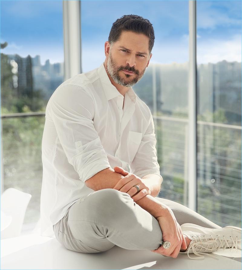 A summer vision, Joe Manganiello wears a John Varvatos white shirt with Bottega Veneta jeans, and Converse high-top sneakers.