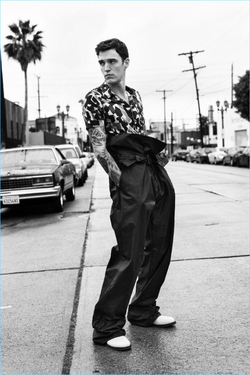 Appearing in a black and white photo, Josh Beech wears a spring look by Bottega Veneta.