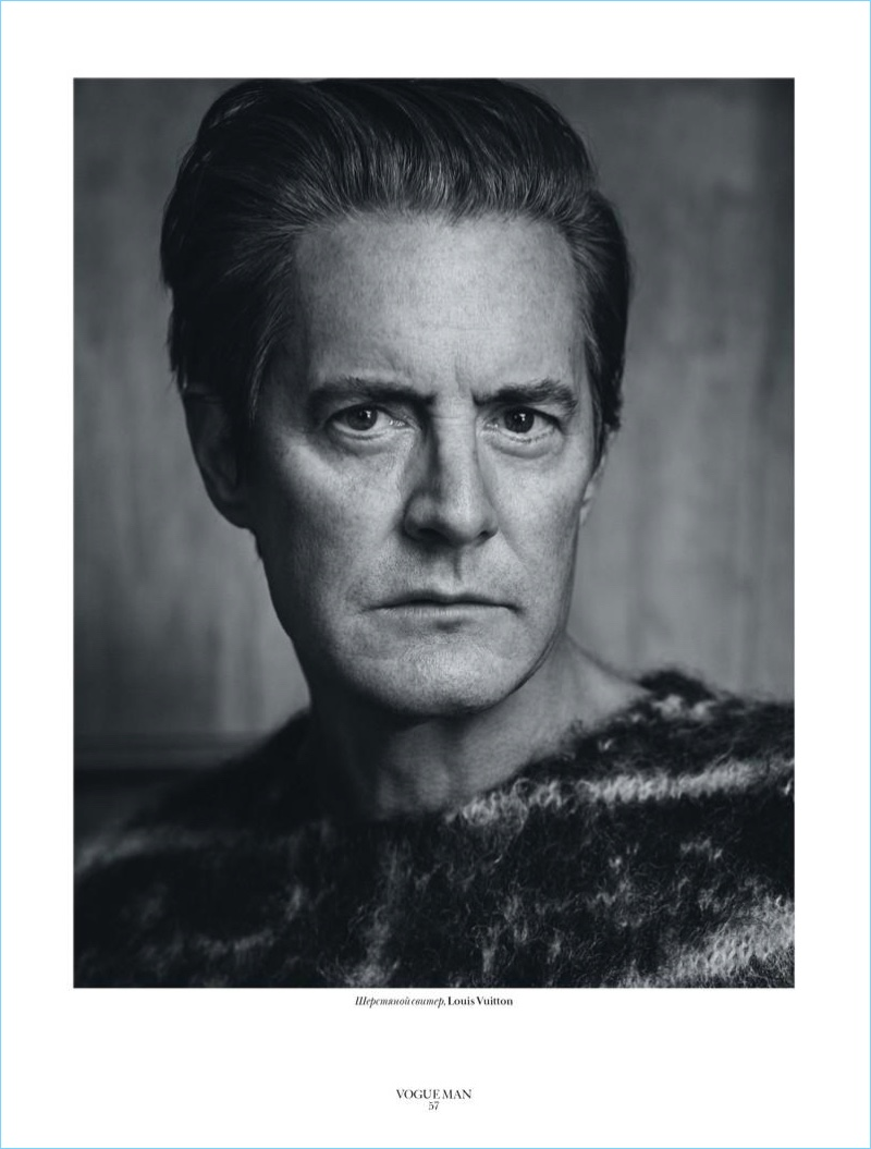 Appearing in a black and white image, Kyle MacLachlan sports a Louis Vuitton sweater.