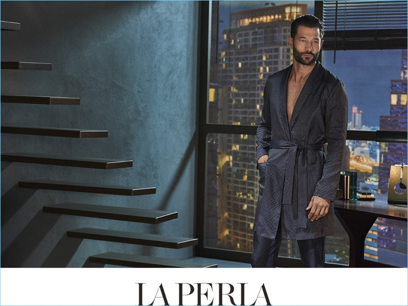 Lounging, John Halls wears a silk night robe and pajama pants for La Perla's spring-summer 2017 campaign.