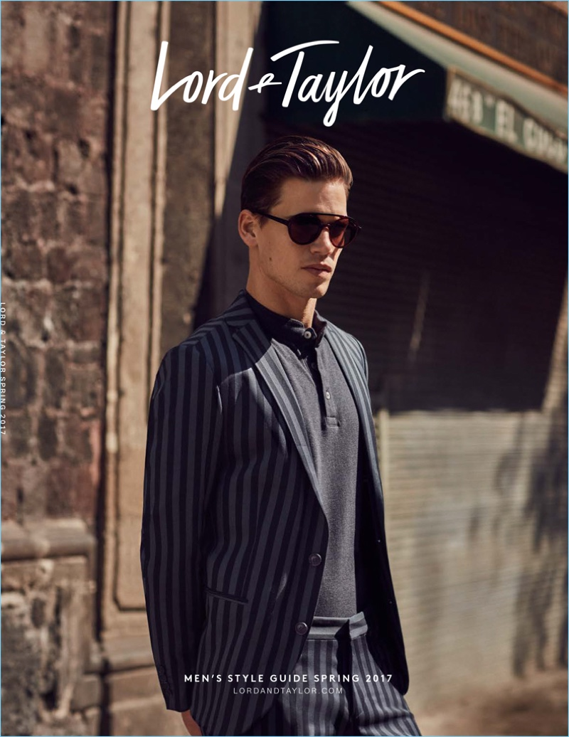 Covering Lord & Taylor's spring 2017 men's catalogue, Mark Cox dons a Selected Homme striped suit jacket $255 and pants $150 with a navy polo by Selected Homme.