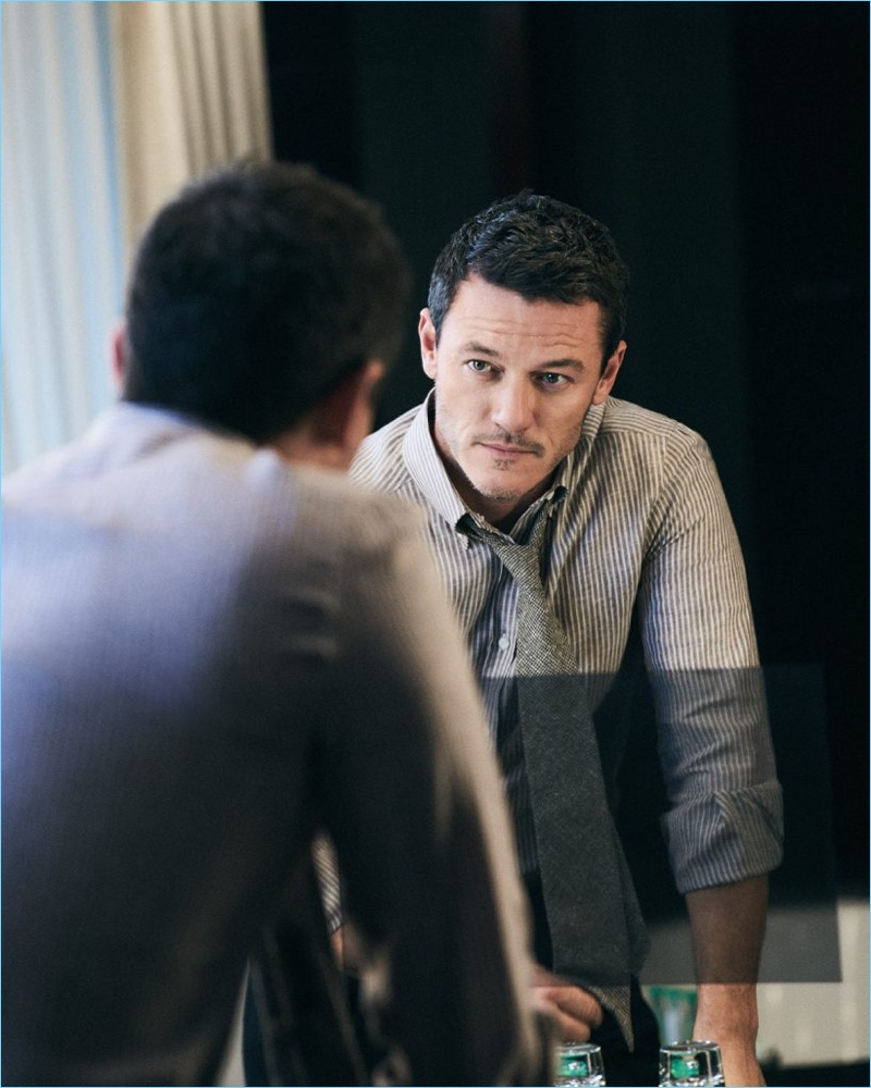 Luke Evans wears a striped Brunello Cucinelli linen shirt with Rubinacci trousers and a Thom Sweeney tie.