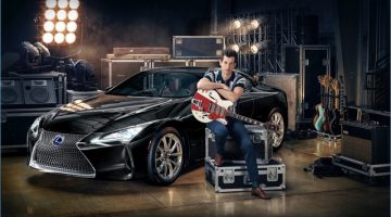 Posing with Lexus' LC coupe, Mark Ronson sports a retro-style polo shirt with slim-fit trousers.