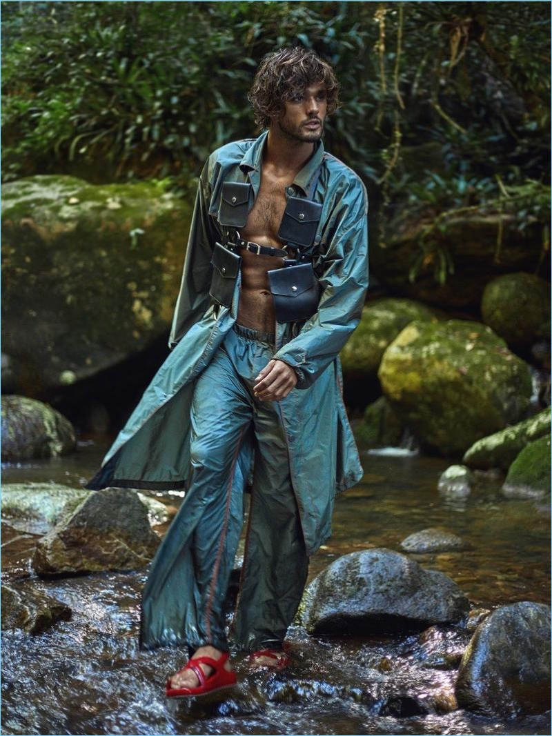 Clad in Prada, Marlon Teixeira accessorizes with a harness by Zana Bayne.