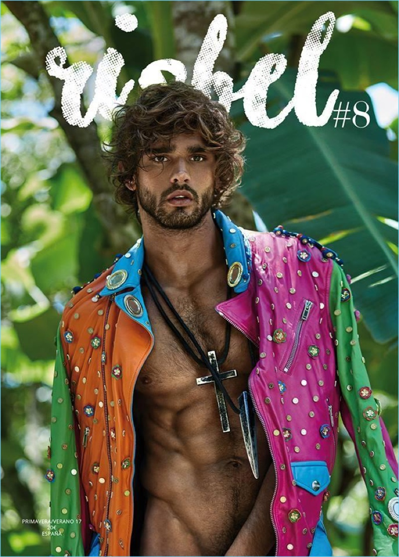Marlon Teixeira covers Risbel magazine in a Moschino multi-colored leather biker jacket.