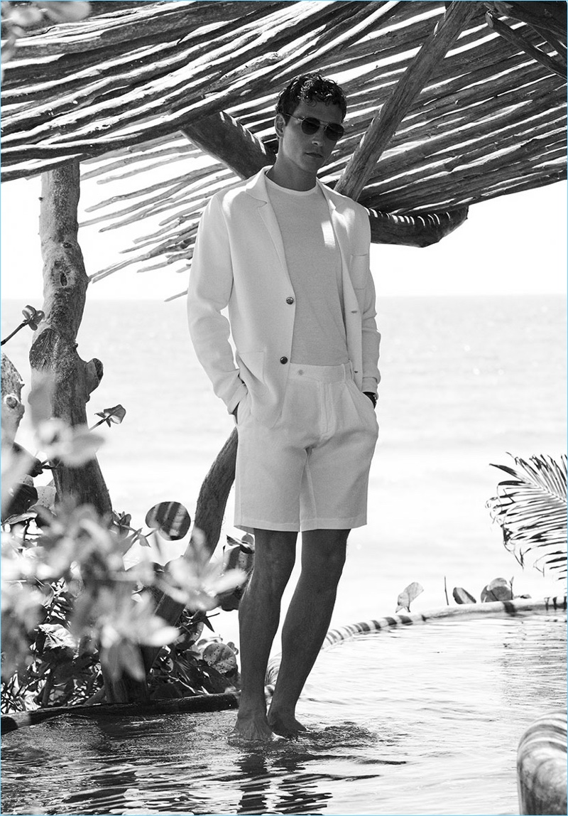 Alexandre Cunha wears white short suit from Massimo Dutti.