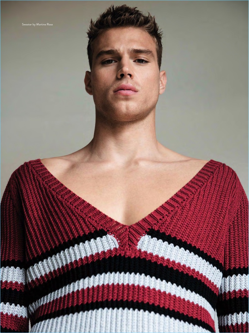 Model Matthew Noszka wears a colorful sweater by Martine Rose.