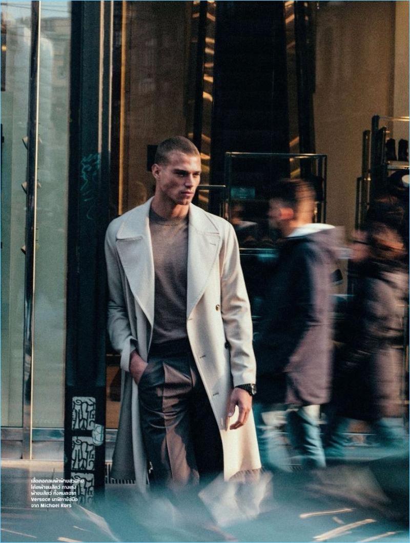 Venturing outdoors, Matthew Noszka wears Versace and Michael Kors.