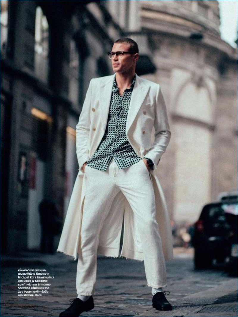 Sporting a dapper white look, Matthew Noszka dons brands such as Michael Kors, Dolce & Gabbana, and Ermanno Scervino.