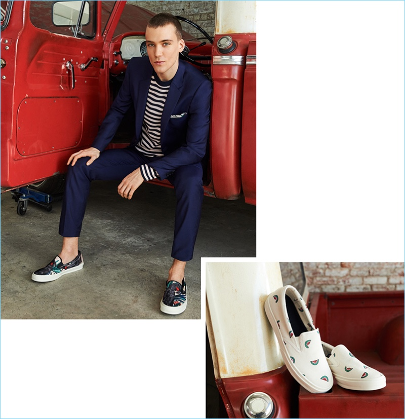 East Dane enlists Marc Lüloh for a PS by Paul Smith lookbook featuring the brand's striped sweater, mid-fit wool nested suit, and print slip-on sneakers. Marc also accessorizes with a printed Paul Smith pocket square.