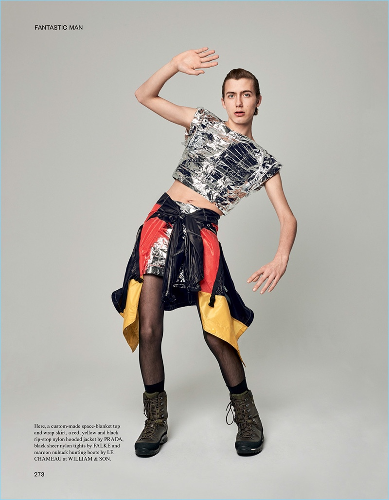 Wearing custom clothes, Paul Hameline rocks a Prada jacket tied around the waist with hunting boots by Le Chameau.