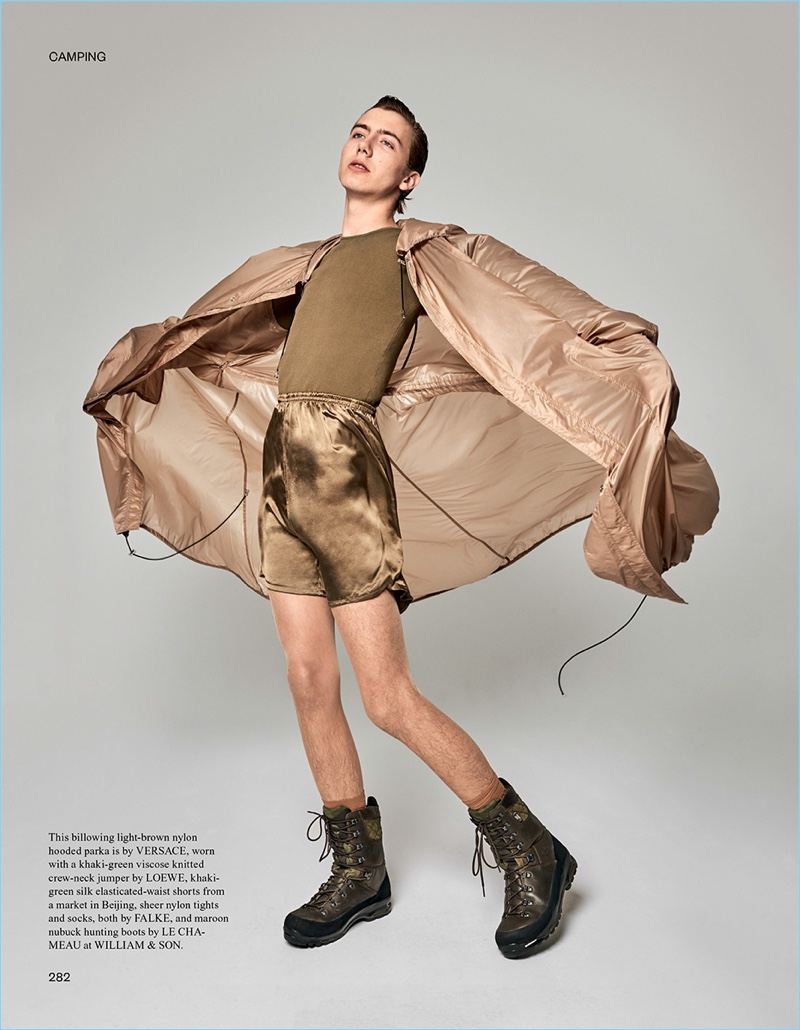 Model Paul Hameline sports a Versace hooded parka with a Loewe sweater and Le Chameau hunting boots.