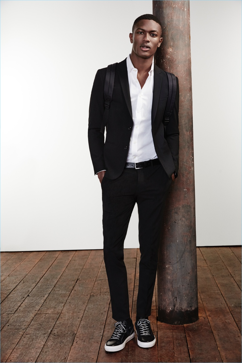 Hamid Onifade is a sleek vision in a River Island black skinny suit jacket $60 and trousers $40.