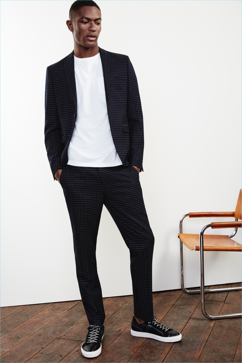 British fashion brand River Island delivers a navy polka dot suit with a sharp skinny fit jacket $220 and pants $80.