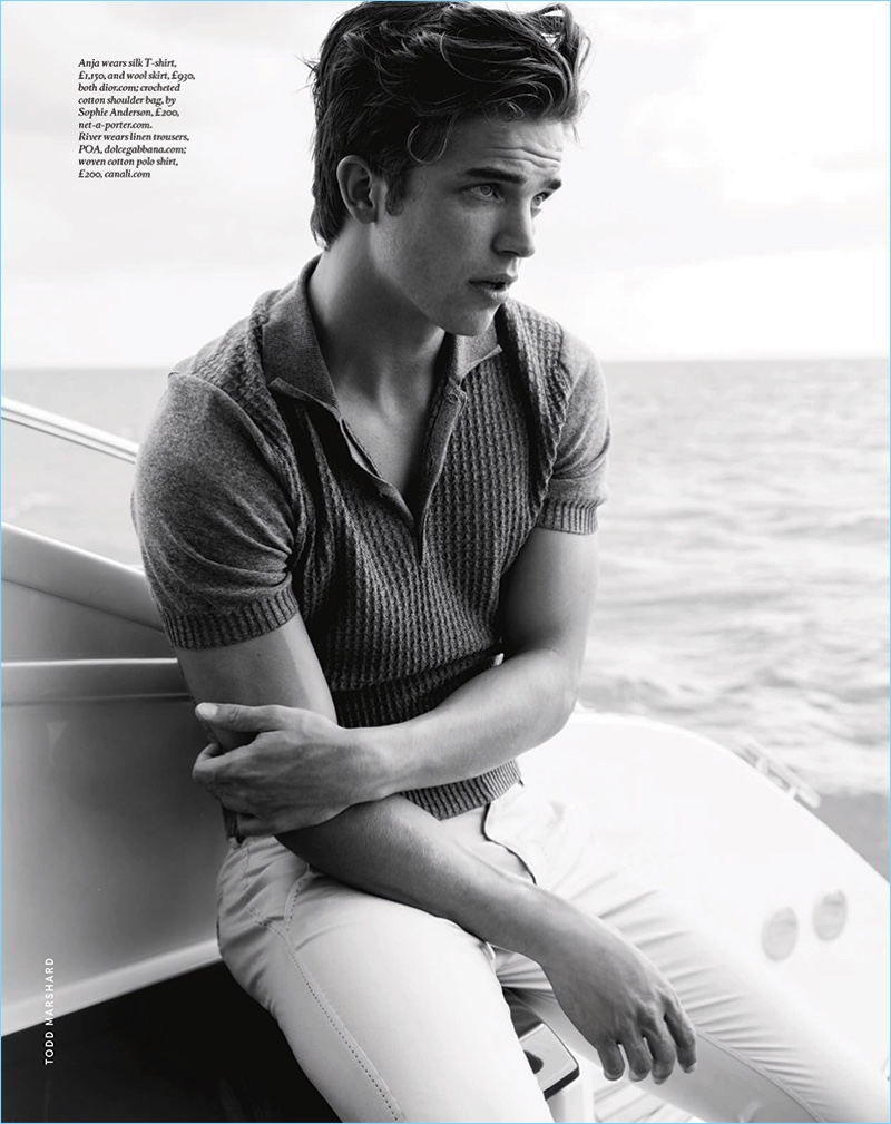 Appearing in a black and white image, River Viiperi wears a Dolce & Gabbana linen trousers with a Canali polo.