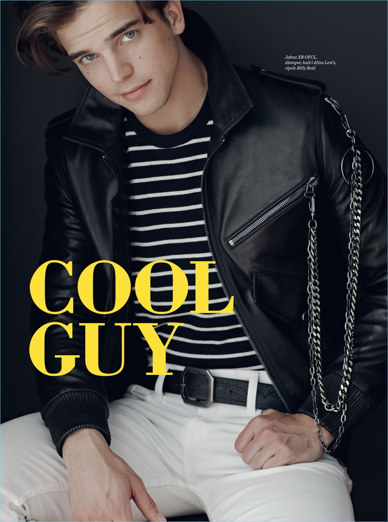 Model River Viiperi dons a leather biker jacket by XBOFCL with a Levi's striped tee and denim jeans.