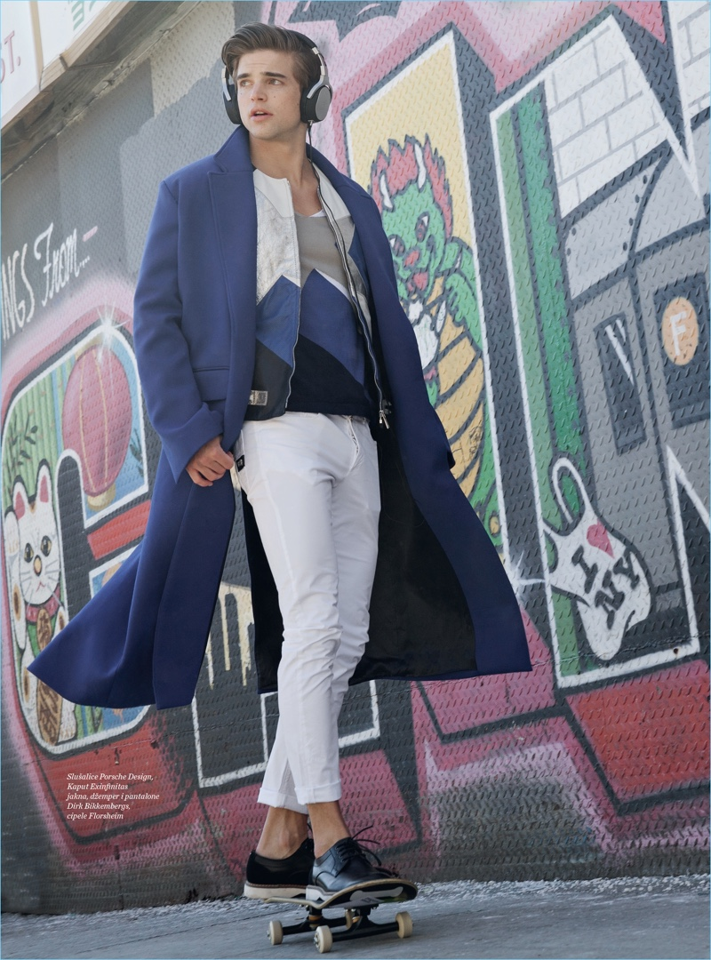 Skateboarding, River Viiperi dons a luxurious Porsche Design coat and Florsheim shoes with Dirk Bikkembergs pieces.