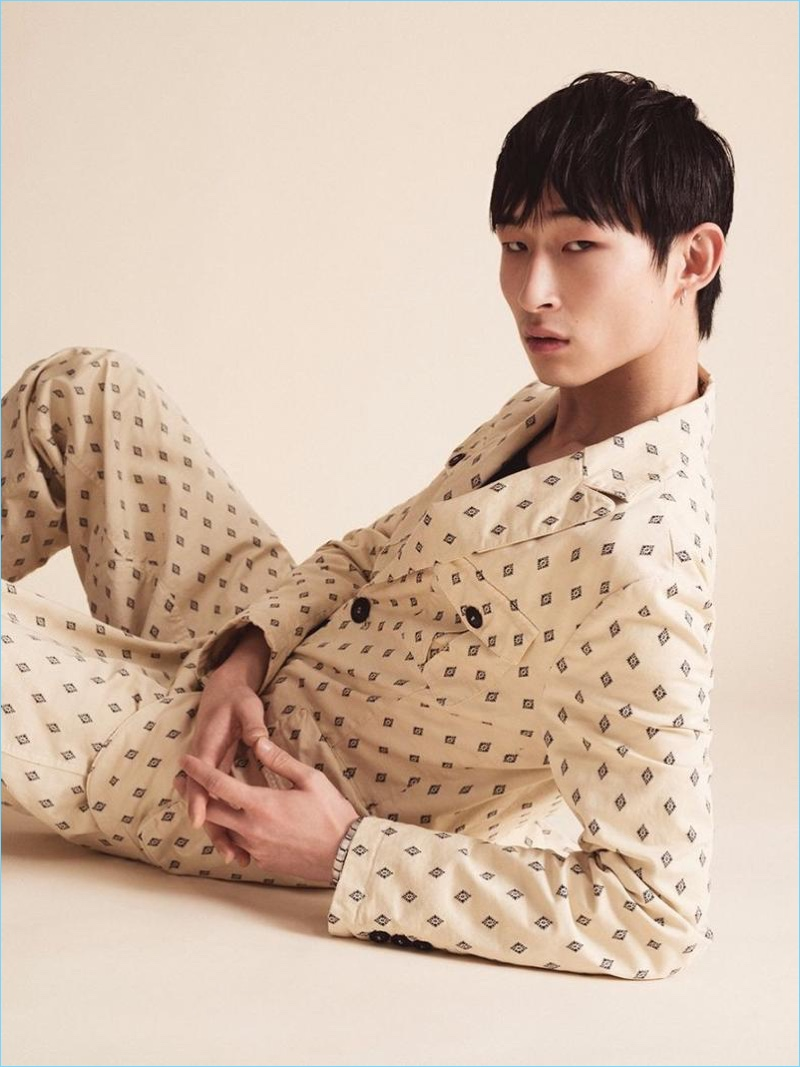 Sang Woo Kim models a pajama-inspired number from Giorgio Armani's spring-summer 2017 collection.
