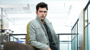 Starring in an editorial for GQ Russia, Sean O'Pry sports a Bally wool coat with a shirt and plaid suit by Etro. Sean also wears A.Testoni brown leather dress shoes.