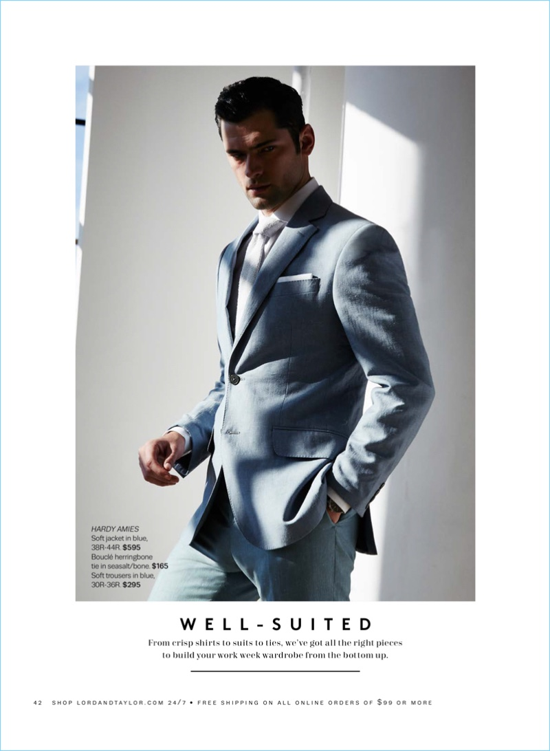 Well-suited, Sean O'Pry dons a blue Hardy Amies soft jacket $595 and trousers $295. Sean also sports a Hardy Amies bouclé herringbone tie $165.