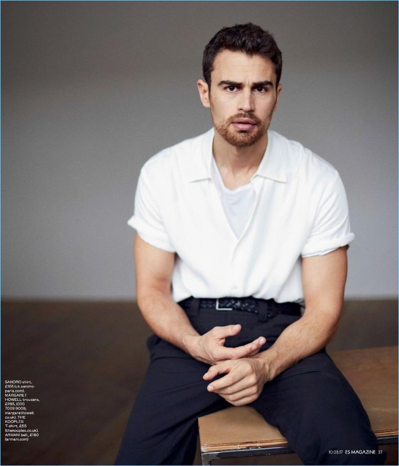 Theo James wears a Sandro shirt, Armani belt, and The Kooples t-shirt with Margaret Howell trousers.