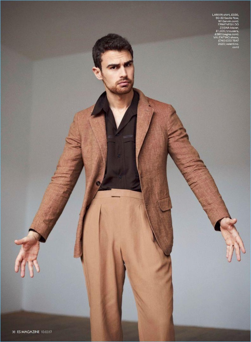 Front and center, Theo James sports a Lanvin shirt with an Ermenegildo Zegna blazer and trousers.