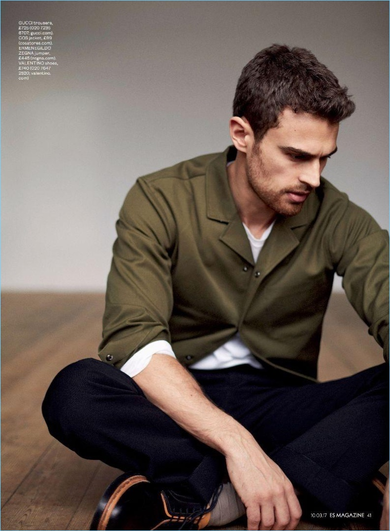 Starring in a photo shoot for ES magazine, Theo James wears a COS jacket, Ermenegildo Zegna sweater, Gucci trousers, and Valentino shoes.