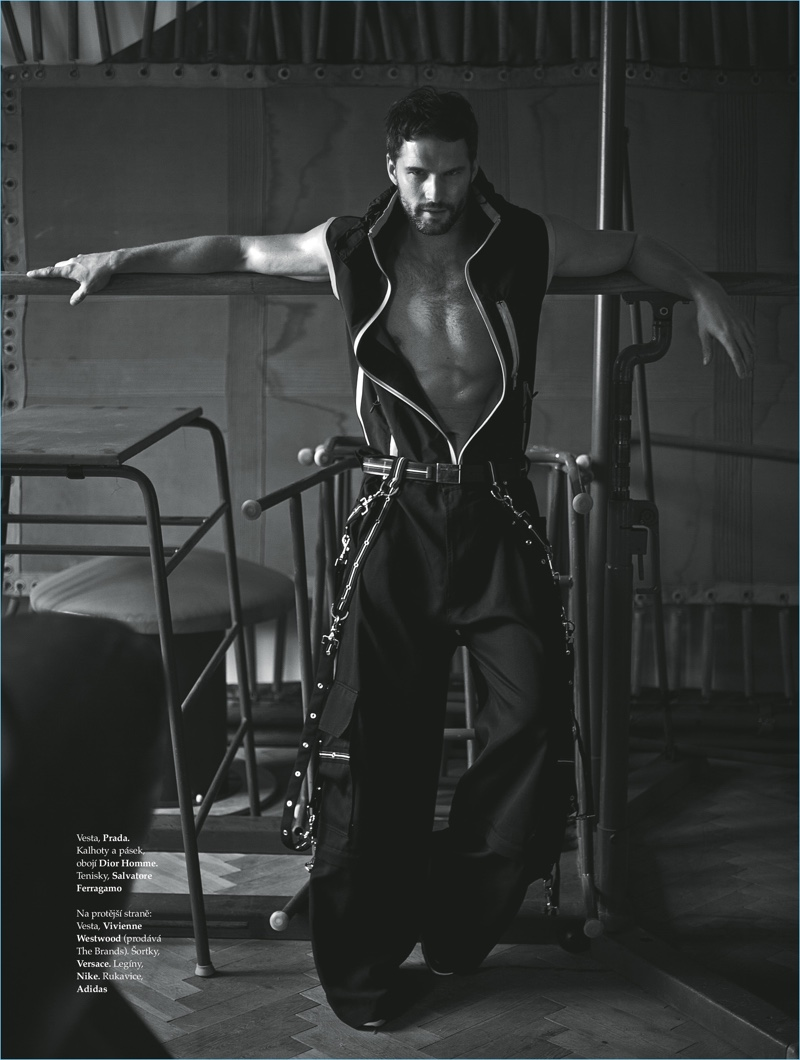A sporty vision, Tomas Skoloudik wears a Prada vest with Dior Homme trousers, and Salvatore Ferragamo shoes.